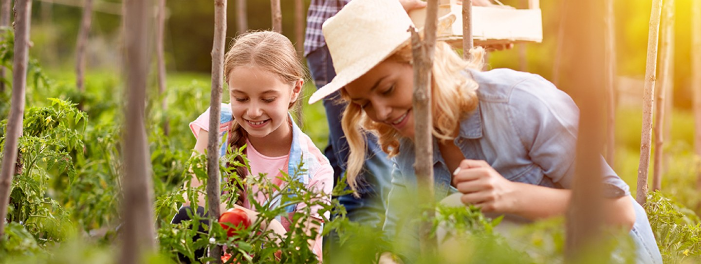 Mom with Girl Gardening